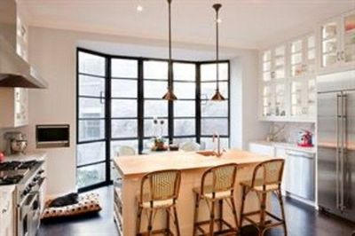 Black framed metal windows white cabinets carrera marble Nate berkus kitchen design