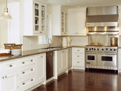 In love with the kitchen. White Cabinets, Hardwood Floors, and Stainless appliances :)