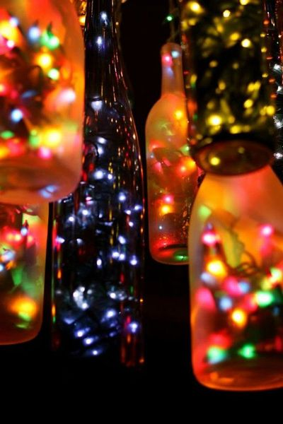 Fancy lights made from wine bottles filled with fairy for Wine bottle patio lights