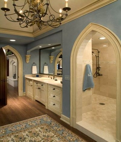 master bathroom with huge walk in shower and arches / bath