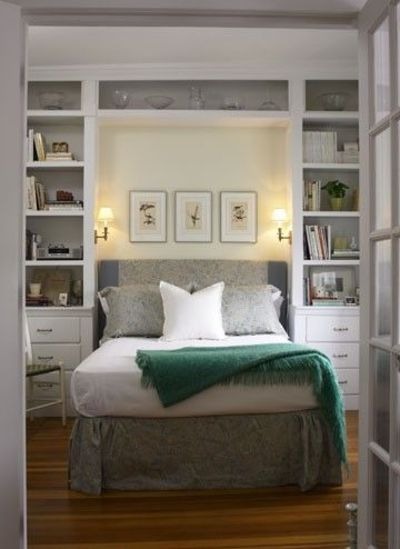 custom shelving around bed a must for the bedroom