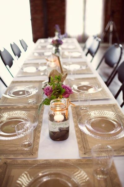 Table Setting With Clear Plates And Paper Placemats