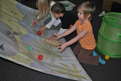 Ramps for rolling balls - encourages coordination and teamwork. Simple but such a great idea!!!! - re-posted by