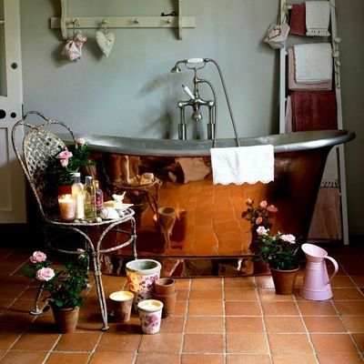 Bathroom With Gray Walls Copper Tub And Terracotta