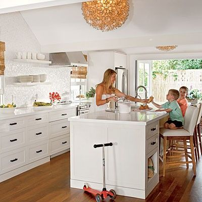 White kitchen with natural wood accents on roman shades for Key west style lighting