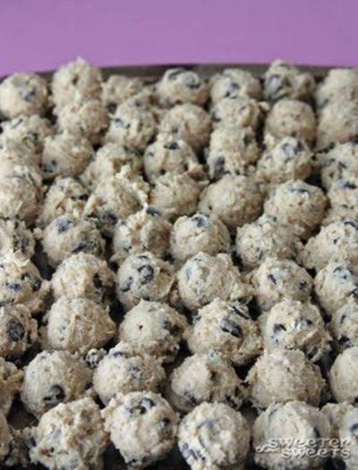 When making cookies or scones only bake a few, then scoop all the rest of the dough onto a small cookie sheet and freeze the whole tray of pre-scooped dough. You can have fresh-baked cookies whenever you want!