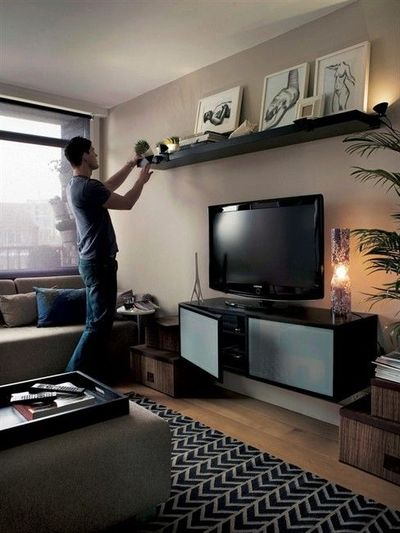 Your shelf could also be a focal point above tv for the - How high to hang tv in living room ...
