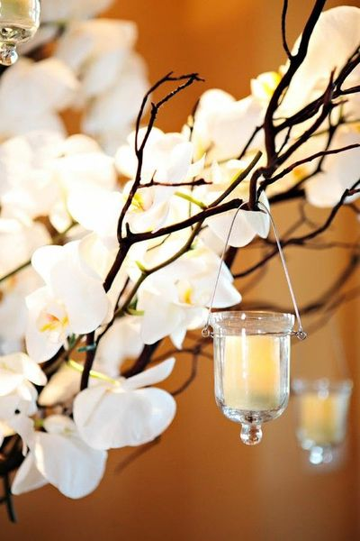 Branches and hanging votive wedding centerpiece