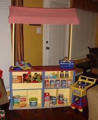 Grocery Store stand from www.gigglesgalorenmore.blogspot.com