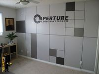 This makes my inner nerd glee with happiness. A portal-themed room? Yes please.