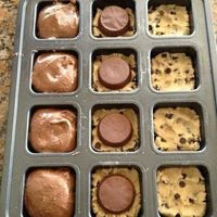 Easy breezy! - preheat oven to 350; smoosh 1.5 squares of break-apart refrigerated cookie dough into the bottom of each well. place reese cup upside down on top of cookie dough (or an oreo!). top with prepared box brownie mix, filling 3/4 full. ba...