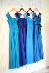 dreamy blue bridesmaids dresses. LOVE the monochromatic look.