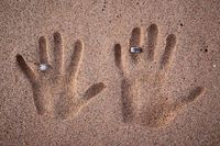 Hand-prints in the sand with rings on honeymoon! Adorable!