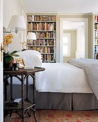 The Master Bedroom: an upholstered headboard is ideal for reading in bed. Wall lamps provide proper lighting while freeing up space on the end tables.