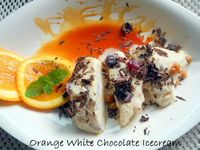 White Chocorange Icecream With Dryfruits: One of my innovations and variation Orange White Chocolate Icecream �€� I have used white chocolate, oranges, orange juice, dry fruits, cranberries, craisins hence came up with this unique name of White [rea...
