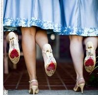 The bride wrote heartfelt messages on the bottom of the bridesmaids' shoes....love it!