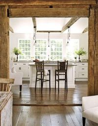 White kitchen with exposed beams and timber.