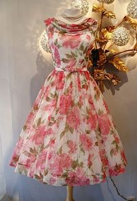 From the archives of Xtabay Vintage Shop..THE Betty Draper dress, rose print chiffon quintessential early 60's party dress.