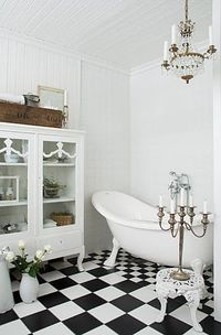 classic black and white tile; gorgeous bath