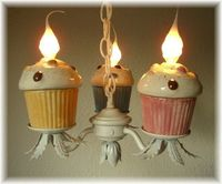pink, blue, tan cupcake chandelier with white iron metal flower base. Angel Heart Designs