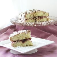 Royal Malibu Coconut Cake W/ Raspberry Jam: A delicious coconut cake layered with raspberry jam, Malibu Rum icing, and chocolate ganache drizzle...[read more at Food Frenzy]