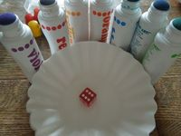 Use your dot art, dice and coffee filters for this easy Math game for preschoolers.