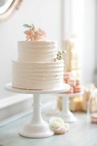 Wedding cake and macarons in pale pink/ peach