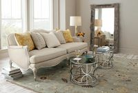 great mirror, sofa with nailhead trim and awesome rug