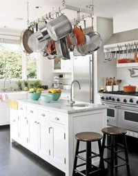 cozy kitchen with pot hanger above island
