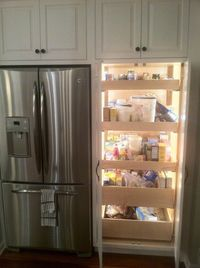 Lighted Pantry with pull out drawers. this is genius.