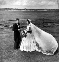 John F. Kennedy (1917-1963), with his wife, Jacqueline Kennedy Onassis (1929-1994), on their wedding day. Photographed by Toni Frissell (1907-1988), 1953