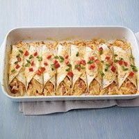 Chicken Enchiladas using Philly Santa Fe cooking creme. SO YUMMY! I sub chicken breasts for canned chicken (easier to shred) and I sub diced tomatoes for a can of Rotel