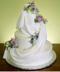 Wedding cake with fondant swags and gumpaste roses and floral sprays