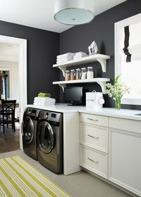 laundry room dark walls, white cabinetry
