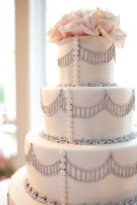 pale pink, silver and white wedding cake..