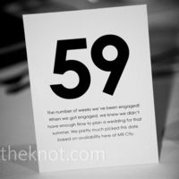 cute. each table number is a # that's meaningful to the couple and the story is shared on the card.