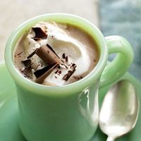 Chocolate curls dress up this toasty coconut hot chocolate.