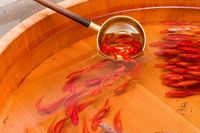 3D painted goldfish embedded in layers of resin