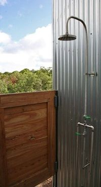 This indoor/outdoor shower idea may work well with a fresnel or soda can solar water heater.