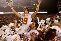 COLLEGE STATION, TX - NOVEMBER 24: Justin Tucker #19 of the Texas Longhorns celebrates with teammates after kicking the winning field goal as time expired in the second half of a game against the Texas A&M; Aggies at Kyle Field on November 24, 2011 in...